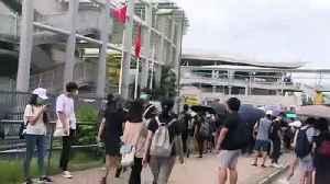 Hong Kong protesters burn Chinese flag [Video]