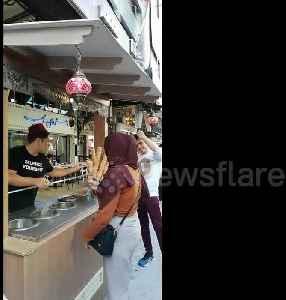 Malaysian vendor continuously tricks customer into grabbing ice cream cone [Video]