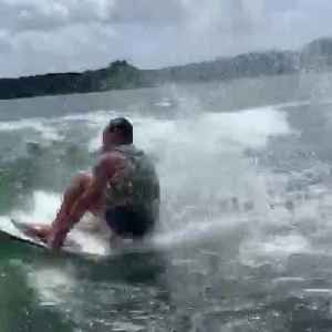Skimboarder Tries Combination of Flips and Fails [Video]