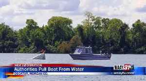 Authorities Pull Boat From Water [Video]