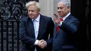 Watch: Netanyahu joins Johnson outside number 10 on surprise visit to London [Video]