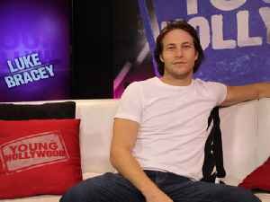 'November Man' Star Luke Bracey on Spiders, Bagpipes, and Dad Jokes [Video]