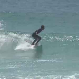 Surfer Rides Waves and Gets Hit by Surfboard in his Face [Video]