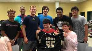 High School Football Team Surprises Fan With Cerebral Palsy [Video]