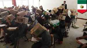Teacher tries to stop cheating with cardboard boxes on heads [Video]
