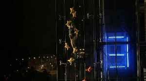 Polish Speed climber beats lift in neon night race [Video]