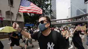Hong Kongers March With US Flags To Plead For Trump's Help [Video]