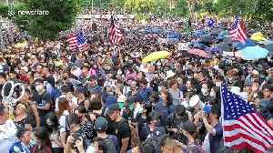 Hong Kong protesters chant 'USA! USA!' in march on US Consulate [Video]