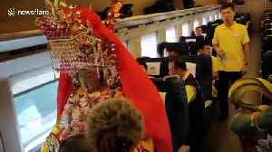 Statue of Chinese sea goddess travels on bullet train with real ticket [Video]