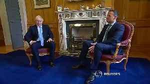 Boris Johnson signs guest book on Dublin trip [Video]