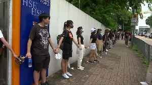 Student protesters form human chain in Hong Kong [Video]