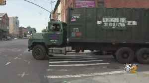 E-Bike Rider In Critical Condition After Being Hit By Garbage Truck [Video]