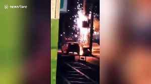 Faulty voltage transformer explodes sending sparks onto Chinese street [Video]