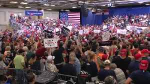 Trump's biggest fan wears Trump's biggest hat [Video]