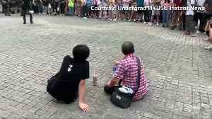 Hong Kong protest 'bottle flip' moment goes viral [Video]