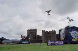 Bikers ride high with treble double backflip [Video]