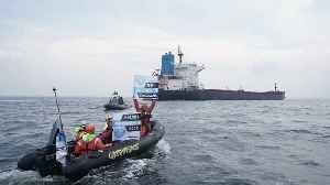 News video: Watch: Polish officers smash windows of Greenpeace ship with sledgehammers