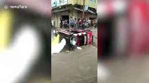 Vehicles swept away by floodwater as incessant rains batter central India [Video]