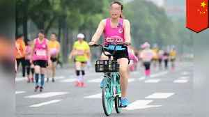 Two Chinese women caught riding bikes in Chengdu half-marathon [Video]