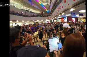 Hong Kong's new protest 'anthem' gets orchestral treatment at Kowloon shopping mall [Video]