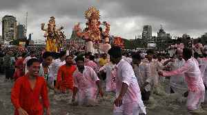 Devotees bid farewell to Ganesh at festival climax