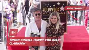 Simon Cowell Shows Love For Kelly Clarkson [Video]