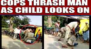 Cops thrash man for violating traffic rules as child looks on | Oneindia News [Video]