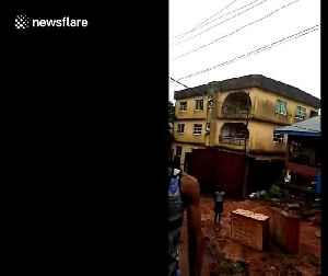 Shocking moment three-storey block collapses in Nigeria after downpour [Video]