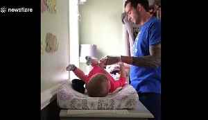 Hilarious moment Michigan dad struggles changing newborn daughter for the first time [Video]