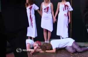 Glue and fake blood: climate protesters hit London Fashion Week [Video]