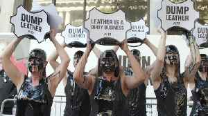 Peta activists douse themselves in 'toxic slime' at London Fashion Week [Video]