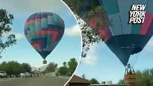Hot air balloon hits tree: 'Talk about a ride!' [Video]
