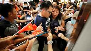 Pro and anti-Beijing groups scuffle in Hong Kong mall [Video]