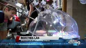 Students learn how to use medical robots [Video]