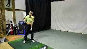 What is the stack and tilt golf swing? [Video]
