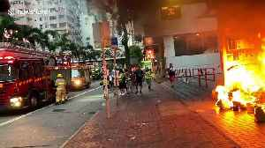 Firefighters put out blaze lit by Hong Kong protesters at Wan Chai station [Video]
