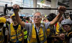 Uncle Wong, 82: protecting Hong Kong protesters with his walking stick – video [Video]