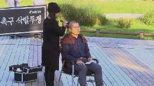 South Korea opposition leader shaves head in protest [Video]