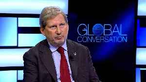 EU commissioner Johannes Hahn defends controversial