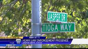 Local community swarmed by law enforcement [Video]