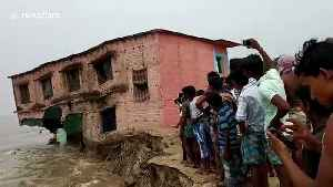 Scary moment school building gets washed away by river in northern India [Video]
