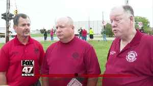 Union members walking the picket line at GM plant in Delta Township [Video]