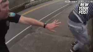 Police officer grabs bridge-jumping man's leg in the knick of time [Video]