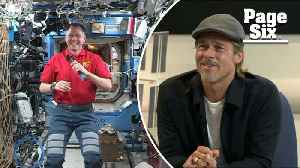 News video: Brad Pitt chats with astronaut about George Clooney
