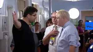 Watch: Parent of sick child confronts Johnson on hospital visit — 'the NHS has been destroyed'