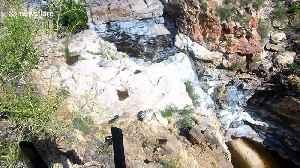 Flash flood turns dry mountain into raging 75-foot waterfall in Arizona [Video]
