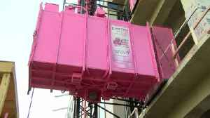 Pink Construction Elevators Raise Money for Breast Cancer [Video]