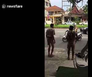 Thai policeman orders schoolboys to do star jumps after catching them riding without helmets [Video]