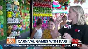 Kari tests out the 'Balloon Bust' at the Kern County Fair [Video]