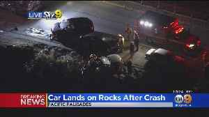 Car Balances On Rocks Above Ocean In Pacific Palisades After Crash [Video]